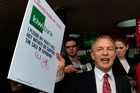 Phil Goff outside Kiwibank in Papakura yesterday after he signed a pledge not to sell the bank. Photo / Brett Phibbs
