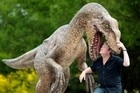 Roger Murray eyes up a model of a dinosaur made for a ride at Rainbow Springs. Photo / Richard Robinson