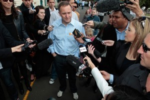 New Zealand Prime Minister John Key talks with media after casting his vote at Parnell Primary School. Photo / Brett Phibbs