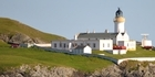 Bressay Lighthouse rises at the entrance to Shetland's main harbour. Photo / Susan Buckland