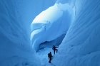 Field instructors Rob McBrearty and Paul Rogers inside the Imax crevasse on the glaciated flanks of Mt Erebus. Photo / Mark Mitchell