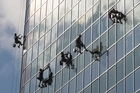 A team of window washers work their way down the National Bank Towers on Queen St in Auckland. Picture / Greg Bowker