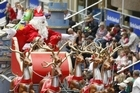 Thousands turn out to see the Santa Parade so perhaps it's best to take your kids somewhere like the Zoo. Photo / Steven McNicholl