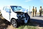The aftermath of the car crash that killed South Canterbury Finance founder Alan Hubbard. Labour is promising a full inquiry into the collapse of the company if elected. Photo / Dan Tasker