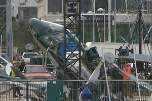 The helicopter crashed this morning while setting up for the installation of a christmas tree. Photo / TVNZ
