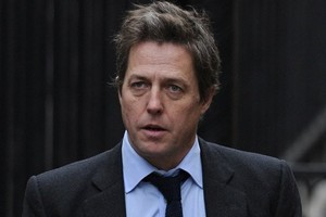 British actor Hugh Grant arrives to attend the Leveson Inquiry in central London. The parents of a murdered schoolgirl whose phone was hacked by the News of the World tabloid, and actor Hugh Grant give evidence on Monday. Photo / AFP