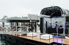 Sunglass Hut launched Australia's first floating pop-up store on Sydney Harbour. Photo / Ken Butti