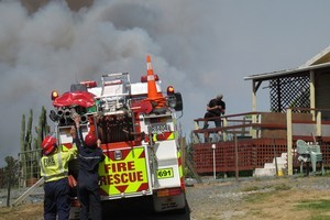 Northland's worst fire in years isn't likely to benefit from light rain expected today. Photo / Peter de Graaf