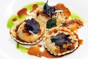 Home-made ravioli with goat's cheese and truffle tossed with Otello's guanciale in red wine sauce. Photo / Supplied