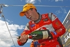 Jamie Whincup driver of the #88 Team Vodafone Holden celebrates after winning race 26 the Sandown Challenge. Photo / Getty Images