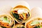 Avocado, hummus, feta and carrot wraps. Photo / Babiche Martens