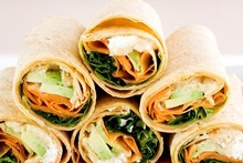 Avocado, hummus, feta and carrot wraps. Photo / Babiche Martens