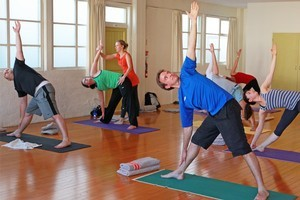 Michael Burgess strikes a pose at one of his many yoga classes. Photo / Doug Sherring
