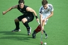 Simon Child (left) has played all over the world for the Black Sticks. Photo / Getty Images