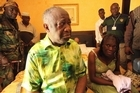 Ivory Coast strongman Laurent Gbagbo and his wife Simone sit on a bed at the Golf Hotel in Abidjan after their arrest on April 11, 2011. Photo / AFP