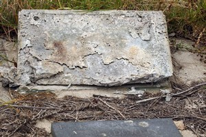 One of the 13 headstones at Waikumete cemetery which had the plaques stolen. Photo / Janna Dixon
