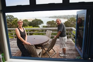 Mary-Anne Boyd and David White are prepared to negotiate in order to sell their much-loved bach at Mangawhai Heads. Photo / Paul Estcourt