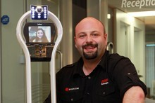 Asnet's Robert Bryson with the robot. Photo / Doug Sherring