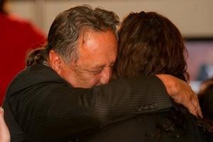 An emotional Pita Sharples hugs a supporter on Saturday night. Photo / Robert Trathen