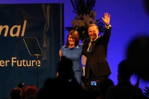 Prime Minister John Key celebrates with his wife and supporters on election night. Photo / Greg Bowker