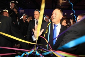 National Party leader John Key celebrates the party's success in the 2011 general election. Photo / Greg Bowker