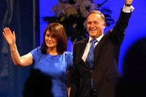 Prime Minister John Key and leader of the National Party talks and celebrates with wife Bronagh Key at election night function at Sky City. Photo / Greg Bowker