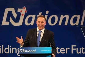 Prime Minister John Key celebrates with supporters on election night. Photo / Greg Bowker