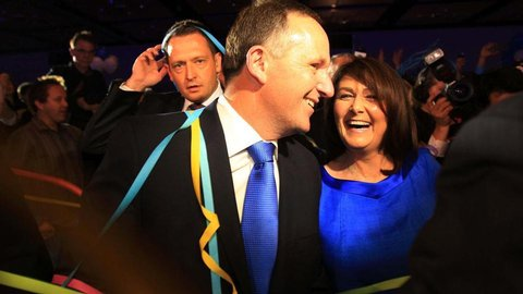 An elated John Key and his equally ecstatic wife, Bronagh, revel in the joy of the National Party's emphatic victory. Photo / Greg Bowker