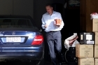 John Key fetches a few celebratory beers from the garage of his Parnell home last night. Photo / Natalie Slade