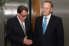 John Key greets Act's John Banks before their coalition talks at the Beehive yesterday. Photo / Mark Mitchell