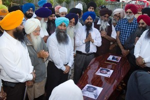 The Sikh community gather in Otahuhu last night to mourn Charanpreet Dhaliwal. Photo / Paul Estcourt