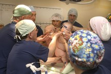 The book includes images of a Waikato Hospital surgical team working to separate conjoined twins. Photo / Waikato DHB