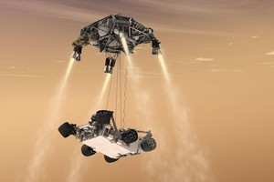 """An artist's impression of the """"sky crane"""" technique that will be used to lower the Mars Science Laboratory Curiosity rover onto the surface of Mars when it lands next August. Photo / NASA"""