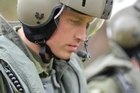 In this July 4, 2011 file photo, Britain's Prince William heads toward a Sea King helicopter for a training exercise. Photo / AP