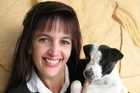 Anita Killeen in a file photo taken in 2009 at the SPCA with her new dog. Photo / Supplied