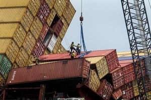 Salvors have not been able to get any more containers off the Rena today. Photo / Alan Gibson.