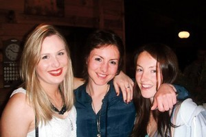 Kimberly McNeill (centre) is busy catching up with friends, such as Beka Bryant (left) and her sister Elana. Photo / Supplied