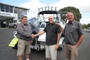 Ian Ross (centre) receives the Haines Hunter from Moller Moyes' Dennis Kendall (left) and Lionel Sands. Photo / Supplied