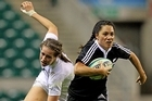 Victoria Grant of New Zealand goes past Emily Scarratt of England. Photo / Getty Images