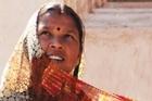 A woman adjusts her sari in the sun. Photo / Liz Light
