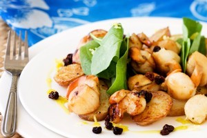 Scallops with potatoes and lemon oil. Photo / Babiche Martens