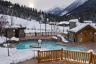 Panorama Springs is a collection of open-air hot-tubs, whirlpool baths and saunas arranged on the terraces between my apartment building and the piste. Photo / Evan Mitsui