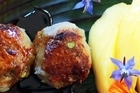 Mango slices add a touch of sweetness to kumara and taro balls and smoked fish. Photo / Doug Sherring