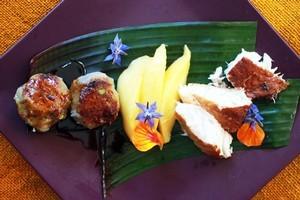 Mango slices add a touch of sweetness to kumara and taro balls and smoked fish. Photo / Doug Sherring