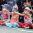 Families enjoy the Farmers Santa Parade. Photo / Natalie Slade