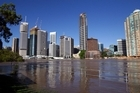 A view of the city high rises after the Brisbane river burst its banks. Photo / Getty Images