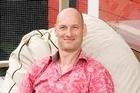 Jerome Partington lazes on his deck made of durable, NZ-grown totara. Photo / Babiche Martens