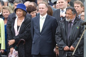 Prime Minister John Key, flanked by Courts Minister Georgina te Heuheu and Maori Party co-leader Pita Sharples. Photo / Mark Mitchell