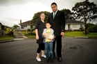 Angela Vili, her son Andy 5, kitten Cookie and Husband Andy Vili outside the house where a man was violently attacked this week. Photo / Herald on Sunday