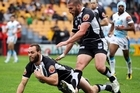 Simon Mannering of the Warriors dives over to score with Lewis Brown in support. Photo / Getty Images
